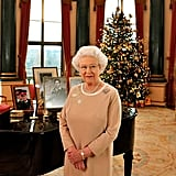 """The queen, 2015: """"At this time of year, few sights evoke more feelings of cheer and goodwill than the twinkling lights of a Christmas tree. One of the joys of living a long life is watching one's children, then grandchildren, then great-grandchildren, help decorate the Christmas tree. And this year my family has a new member [Princess Charlotte] to join in the fun. There's an old saying that 'it is better to light a candle than curse the darkness.' There are millions of people lighting candles of hope in our world today. Christmas is a good time to be thankful for them, and for all that brings light to our lives."""""""
