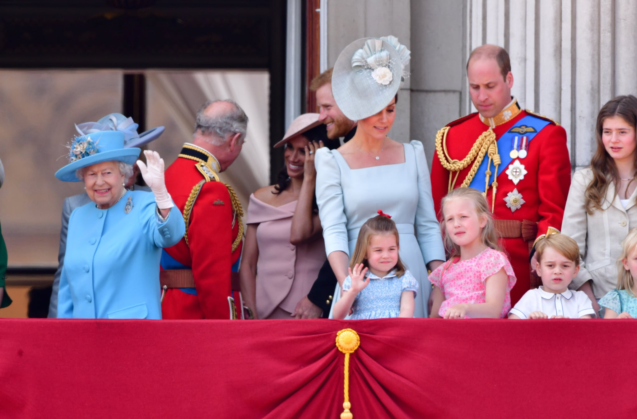 LONDON, ENGLAND - JUNE 09:  Queen Elizabeth II, Prince Charles, Prince of Wales, Meghan, Duchess of Sussex, Prince Harry, Duke of Sussex, Catherine, Duchess of Cambridge, Prince William, Duke of Cambridge, Princess Charlotte of Cambridge, Savannah Phillips and Prince George of Cambridge stand on the balcony of Buckingham Palace during the Trooping the Colour parade on June 9, 2018 in London, England.  (Photo by James Devaney/FilmMagic)