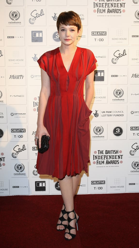 Carey Mulligan looked effortlessly-chic in a pleated Bottega Veneta number with statement accessories — black caged sandals and a woven Bottega Veneta clutch — at the British Independent Film Awards in London.