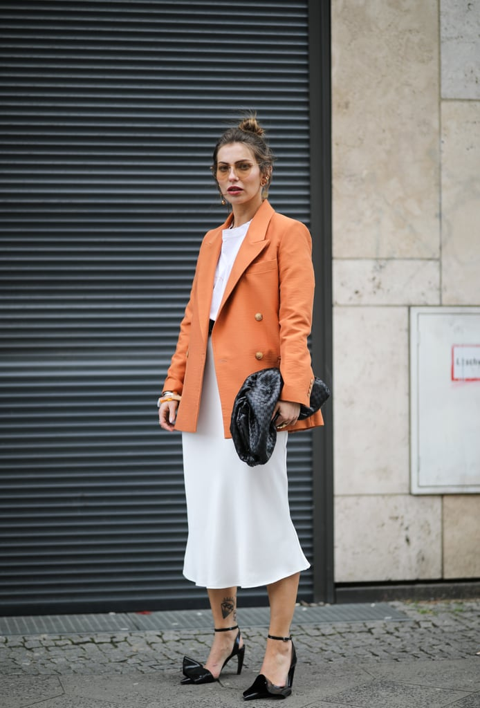 Wear an orange one with a white dress and black heels for the perfect on-the-go look.