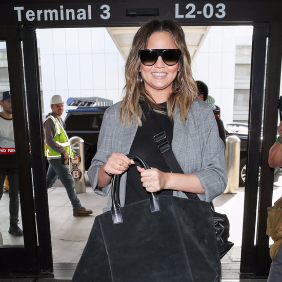 Chrissy Teigen Wearing Black Stiletto Booties at Airport