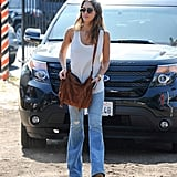Sometimes all you need are a white tank top, a cool pair of flares, and a suede bag to create an on-trend ensemble.