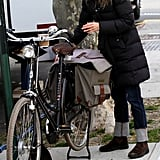 Keri Russell smiled next to a bike.