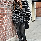 A striped fur chubby topped off slouchy trousers and embellished booties for that Kate Moss brand of downtown styling.