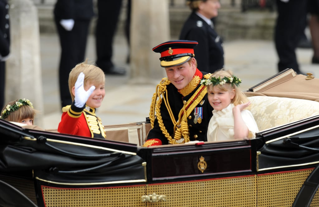 Prince Harry left Westminster Abbey in an open top carriage, following William and Kate's carriage procession this morning. Harry looked after page boy Tom Pettifer and bridesmaids Lady Louise Windsor and Eliza Lopes as they made their way to Buckingham Palace after the royal wedding ceremony. Harry played the part of supportive best man perfectly on his brother's big day, even taking a peek at the bride as she walked down the aisle before William did and whispering to the groom how beautiful Kate looks. The bride and groom and their families will soon take to the balcony for the fly past and first kiss, so stay tuned for more pictures!