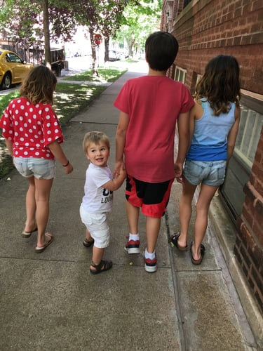 The author's son and cousins out for a walk