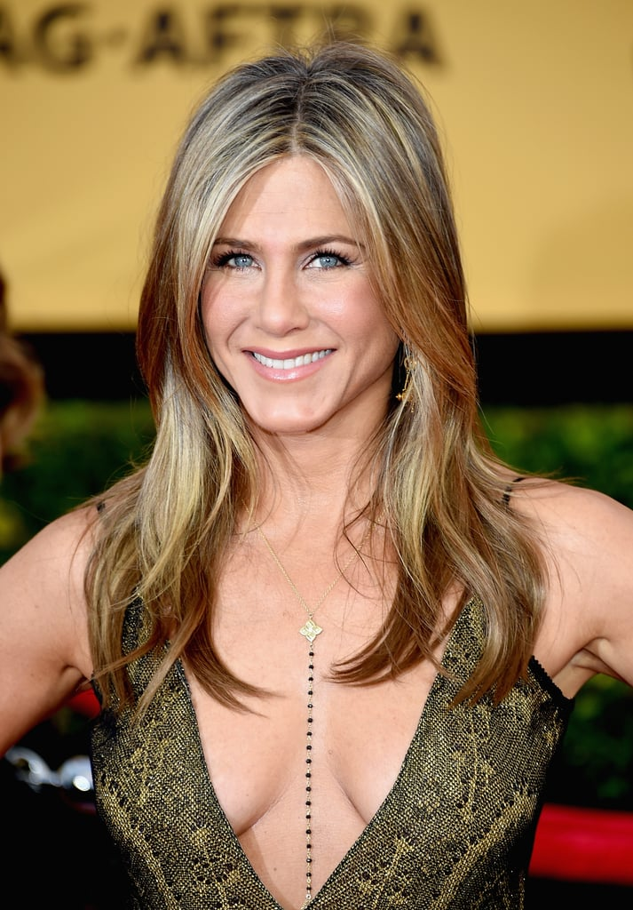 POPSUGAR: How often do you wash your hair, and do you rely on dry shampoo after your workout? Jennifer Aniston: Dry shampoo has kind of been my lifesaver in the last few months. After I work out I usually run a hair dryer through my hair just to kind of dry up the moisture. Then I add the dry shampoo as sort of an added cleanser. It sounds bizarre, but it's actually better day two and day three. It's weird with the dry shampoo, it just kind of gives it more texture and nice, beachy movement. PS: Do you have a technique you use to spray it on?  JA: It's kind of hard to describe it . . . I'm acting it out with my hands. You kind of like part it, spray it, and keep parting it all over your crown and the sides of your head. Then I put a hair dryer through it to air it out and piece it out.