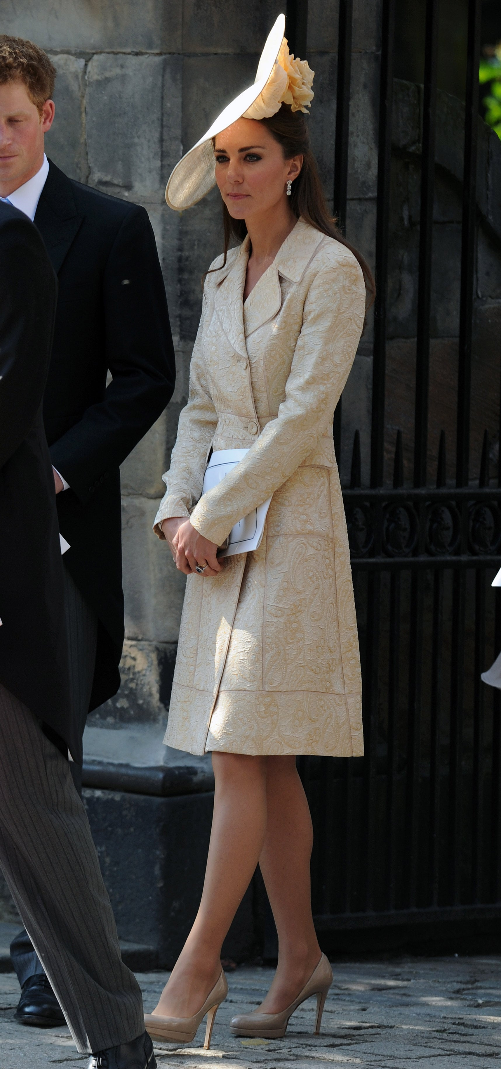 Kate Middleton was one sophisticated wedding guest in a printed coat and matching hat when Zara Phillips got married in Edinburgh in July 2011. To mimic Kate's style, top your wedding attire with a statement coat for the ceremony; then take it off for the reception.