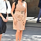 Meghan, Duchess of Sussex Wears A Beige Sleeveless Trench Dress with Matching Beige Pointed Toe Pumps