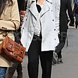Jessica Biel shopped around Paris in a gray coat and black pants.