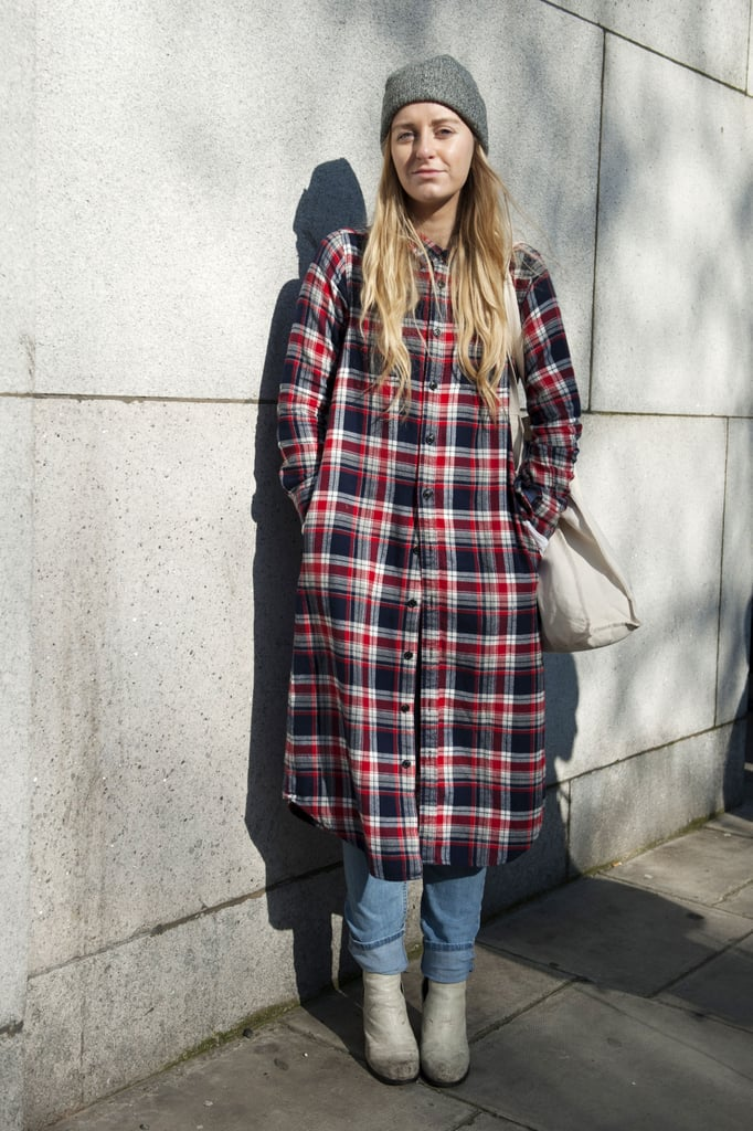 This attendee worked the tomboy angle with a long, plaid button-down and a beanie.