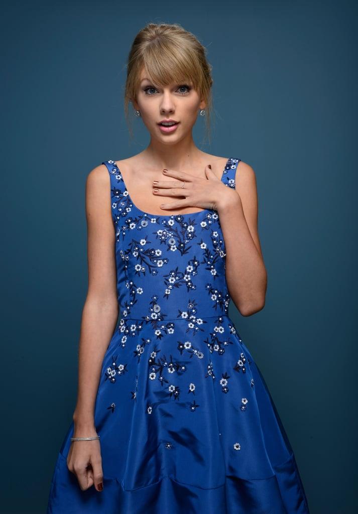 "She gave her best, ""Who, me?"" pose during the Toronto International Film Festival in September 2013."