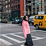 """Fun fact: I was walking back from the bathroom in the office when a coworker screamed, """"OMG! Come over here — we have to talk about this sweatshirt right now."""" I had on a neon pink Marc Jacobs sweatshirt over a floral POPSUGAR at Kohl's dress. While chatting about my little experiment, she actually realized that the Marc Jacobs logo was written backward, which I hadn't even noticed, TBH. It's actually pretty damn brilliant because the logo reads the right way when you take mirror selfies!"""
