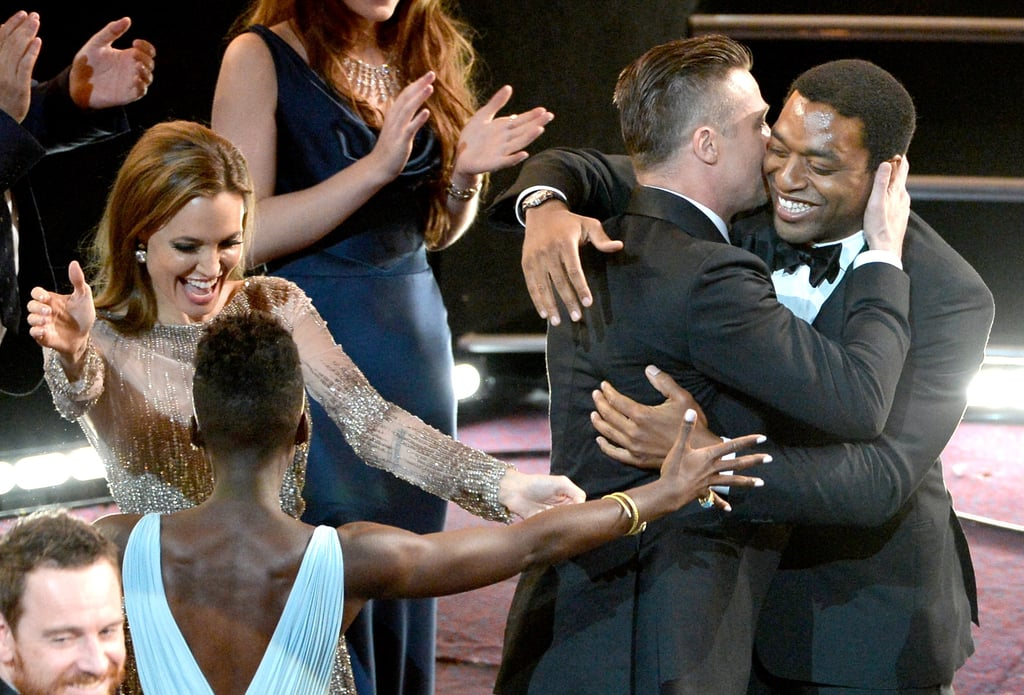 Angelina Jolie, Brad Pitt, Lupita Nyong'o, and Chiwetel Ejiofor couldn't contain their excitement when 12 Years a Slave won best picture at the Oscars.