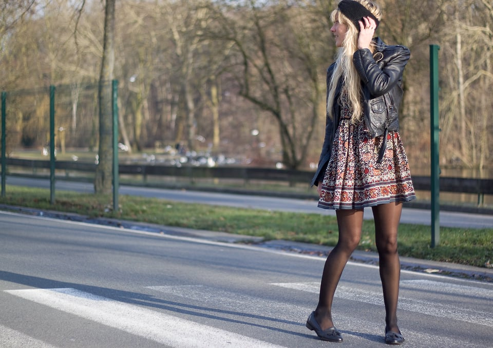 Feeling the autumn chill? Add tights and a leather jacket to your floral-print dress getup. And we're totally loving the tasseled loafers here, too.  Photo courtesy of Lookbook.nu