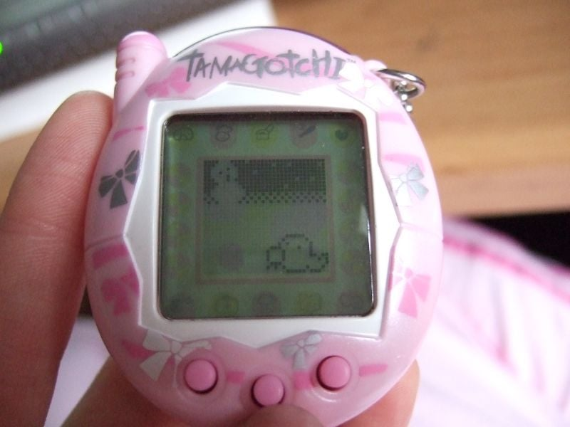 You'd Try to Sneak in Some Time With Your Tamagotchi Under Your Desk