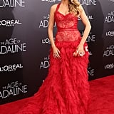 Wearing a Monique Lhuillier gown and carrying a Judith Leiber clutch to the NYC premiere of The Age of Adaline in 2015.