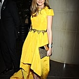 Olivia Palermo brightened up the evening with a cap-sleeved yellow Katie Ermilio gown, which also featured a dramatic high-low hem and a chain-belt detail at the waist. Her purple rope ankle-strap sandals by Jimmy Choo and printed clutch injected a quirkier kind of glamour, but as with all things Olivia Palermo, she certainly made it her own.
