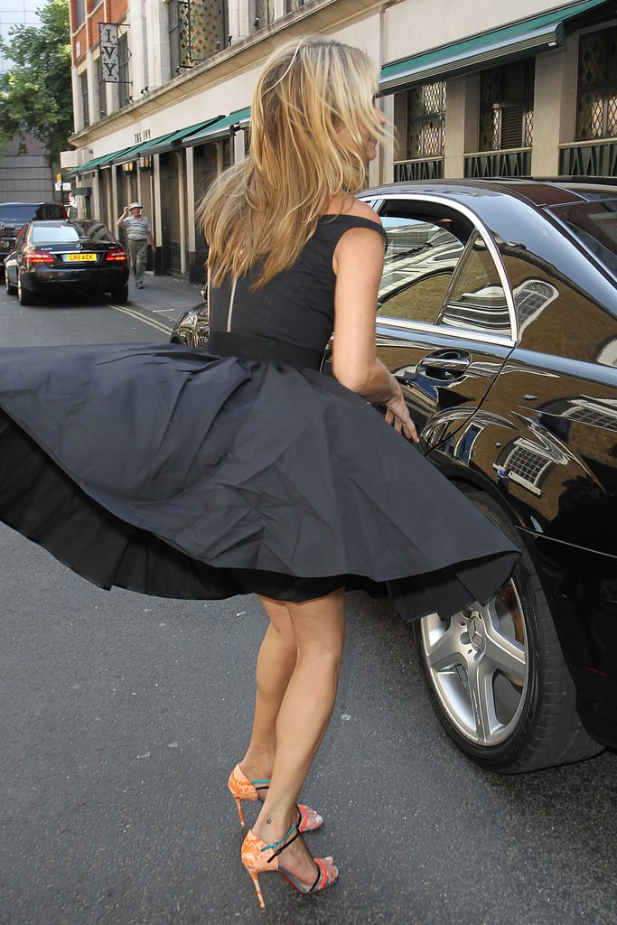 Kate Moss's dress blew up as she made her way into The Ivy Club.