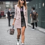 Toughen up a miniskirt and blazer outfit with optic white combat boots.