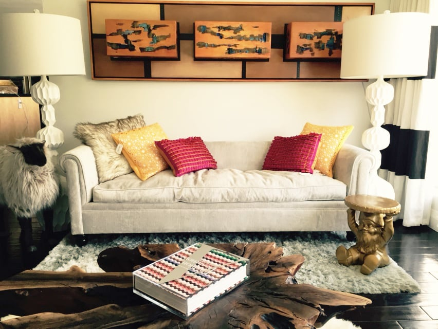 The living space is bookended by two white Beckett Lamps ($259).  David completed his sofa vignette with the addition of Reversible Throw Pillows ($79 each).