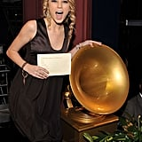 Taylor posed near a Grammy statue at the nomination announcements in December 2007.