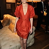 Hunger Games' Elizabeth Banks chose a bold-hued cocktail frock by Andrew Gn.