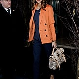 Color-mixing and all, Olivia pulls together a sophisticated jacket and trousers with luxe Manolos and a statement satchel by Mulberry while attending London Fashion Week.