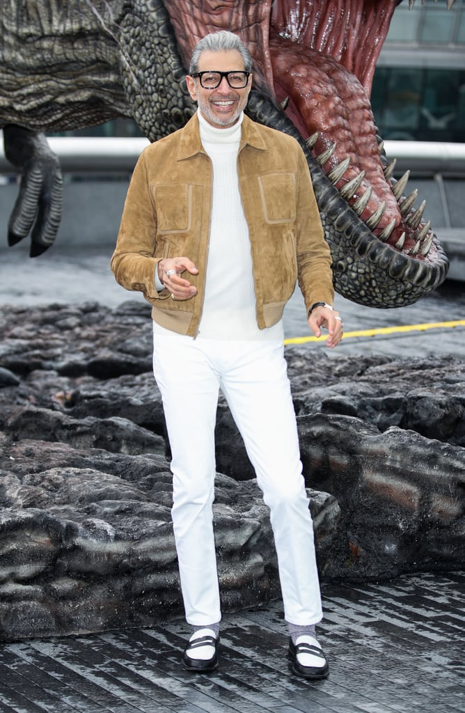If there's one thing we know about Jeff Goldblum, it's that he knows his angles. And the silver-haired, impeccably attired gentleman is busy working them on the Jurassic World: Fallen Kingdom press tour. Jeff stepped out in London on Thursday to willingly pose in front of a T Rex to a Tower Bridge backdrop, looking undeniably delicious. The actor reprises his role as Dr. Ian Malcolm in the fifth installment of the film series, leaving us guessing if he'll be reprising his iconic laugh, too. Laughs aside, if this kingdom is falling, we certainly know who we would want by our side. Jurassic World: Fallen Kingdom hits theaters June 22. Until then, feast your eyes on the following photos like a velociraptor would eye up human flesh.