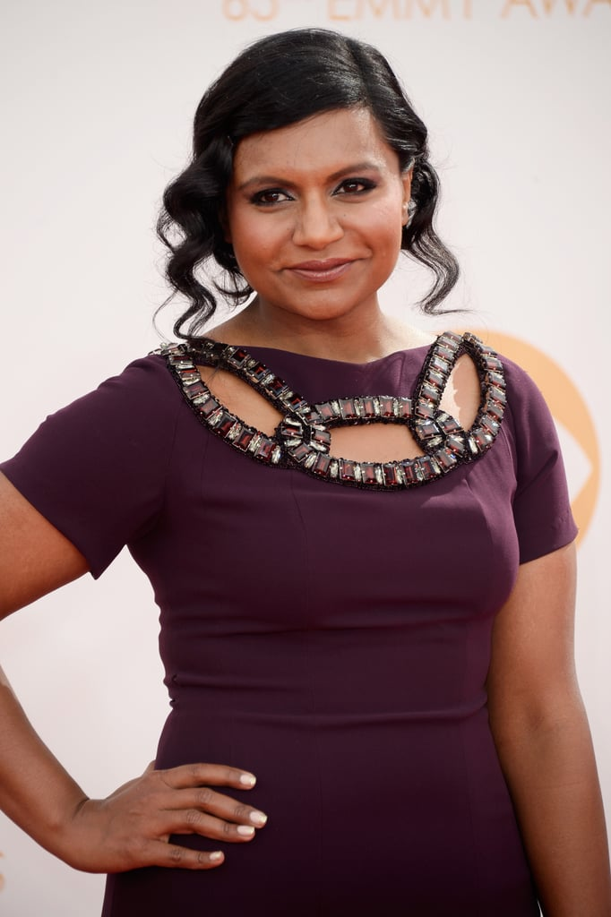Mindy Kaling coupled her plum dress with a aubergine lip gloss, while her hair was styled in a softly curled up 'do.