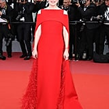 On opening night, Julianne wore a fiery Givenchy Haute Couture cape dress, which was embroidered with ostrich feathers.
