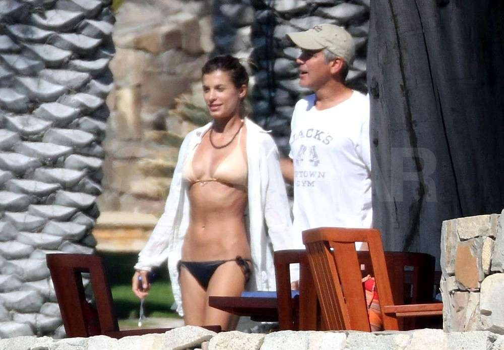 George Clooney and Elisabetta Canalis shared an intimate chat in Cabo yesterday. She also hit the beach in her latest tiny bikini and found a puppy to cuddle up to. Elisabetta kept her face protected from the sun in a cowboy hat, though her bronzed body has been on display in a series of swimsuits during the vacation. George welcomed Elisabetta's family on their getaway as well, and her parents and sister are in Mexico to join in the holiday. George and Elisabetta's chemistry landed them in our hottest celebrity make-outs of 2010 slideshow as they gear up to ring in another year side by side.