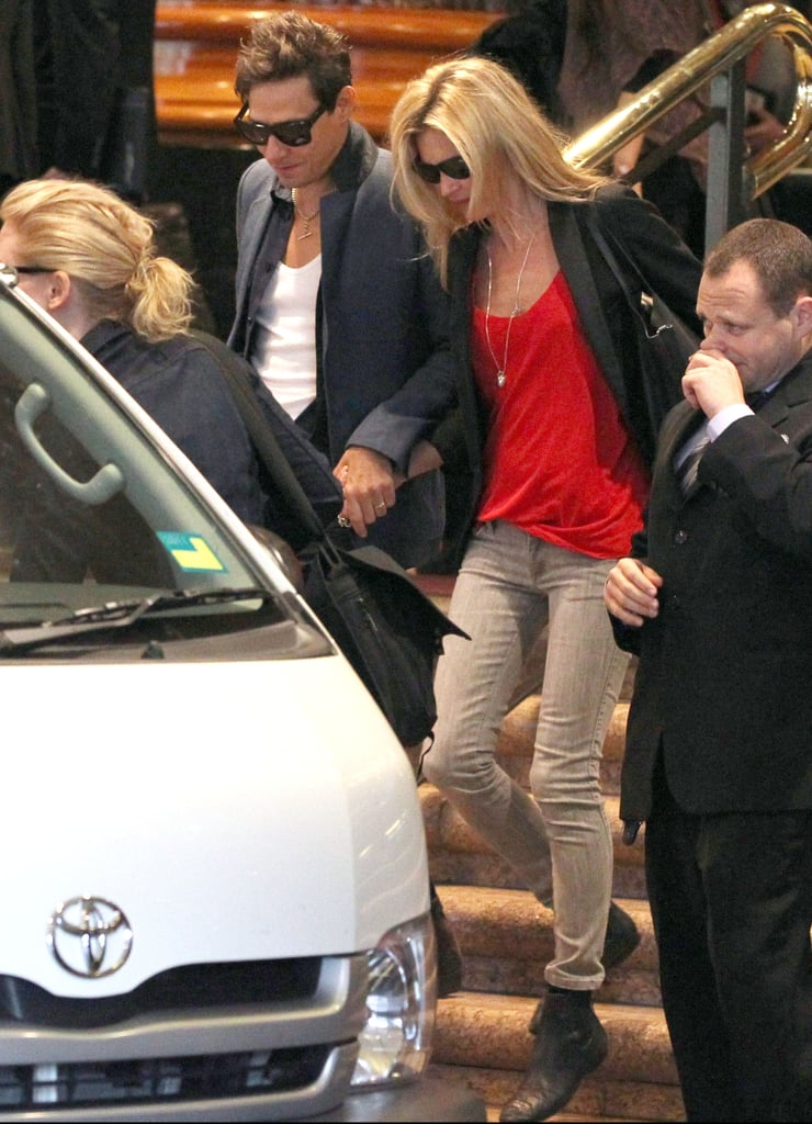 Kate Moss and Jamie Hince hold hands.