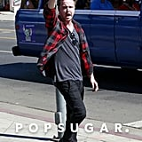 Aaron Paul flashed a peace sign for photographers.