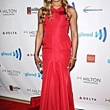 For the GLAAD Media Awards in August 2014, it was all-out elegance in this fiery-red gown.