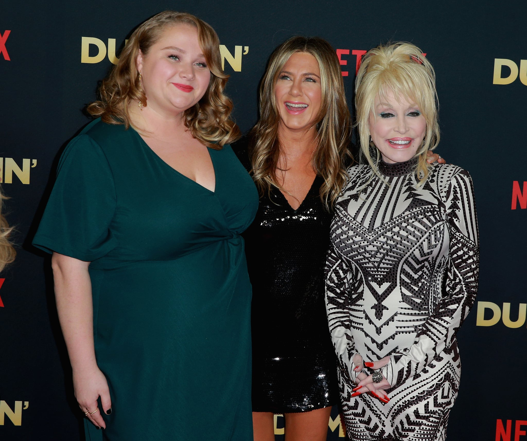 HOLLYWOOD, CA - DECEMBER 06:  Actors Danielle Macdonald and Jennifer Aniston and singer Dolly Parton attend the premiere of Netflix's