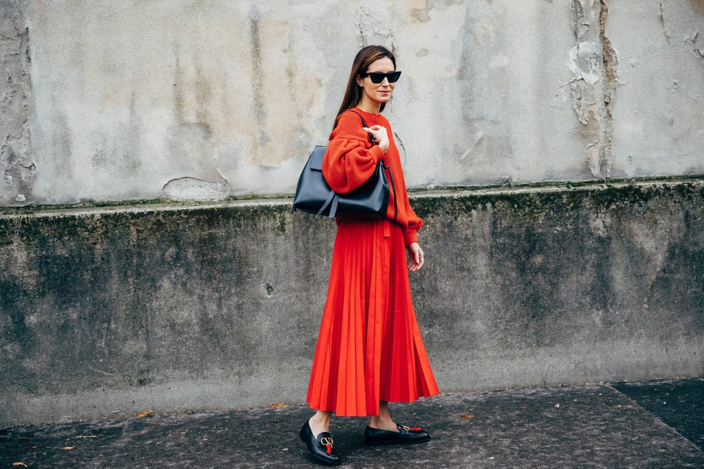 Stand out in a bold pleated skirt and loafers.