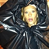 Gisele Bündchen covered up during a rainstorm while shooting for Chanel in Paris. Source: Instagram user giseleofficial