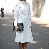 All white is like a blank canvas for showing off a high-wattage clutch.