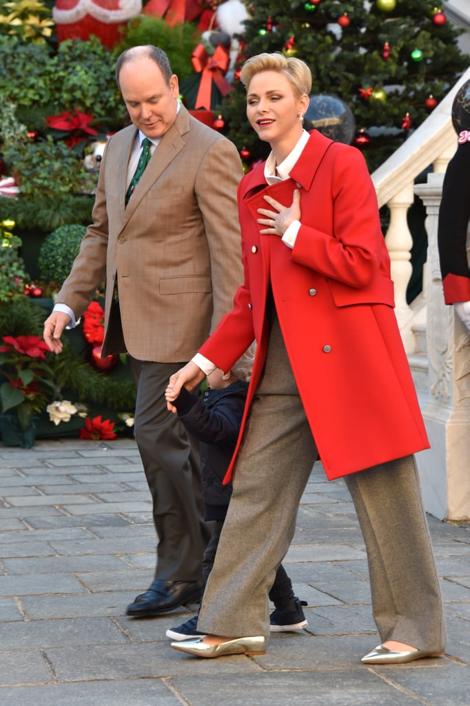 Princess Charlene Stepped Out in a Festive Outfit Complete With a Red Coat