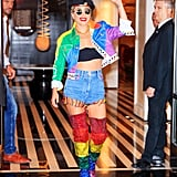 Lady Gaga wearing a custom moto jacket, fringed shorts, and thigh-high boots.