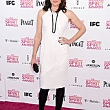 Clea DuVall punched up a simple white sheath with black accents.