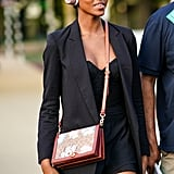 Mix up your year-round mini skirt and blazer combo with the addition of a structured bustier on top instead of a more easy-fitting silk camisole.