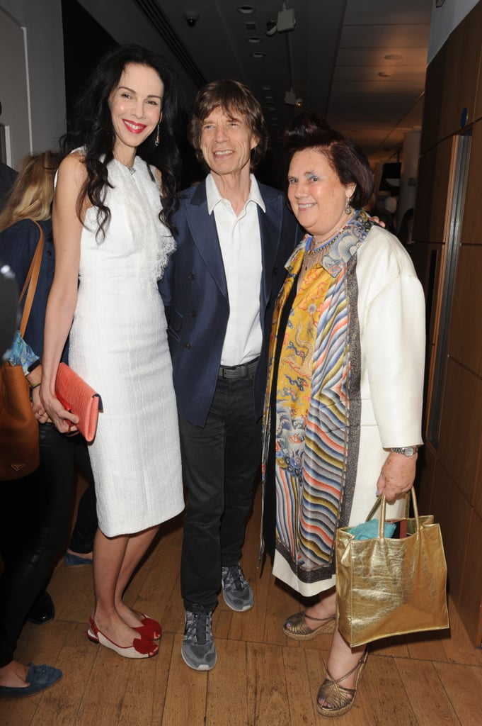 L'Wren Scott and Mick Jagger joined Suzy Menkes for the opening reception of her Christie's collection in London.