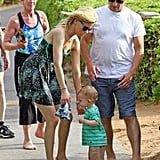 Elizabeth Banks and her son, Felix, got a head start on the celebrating Saturday in Hawaii with dad Max.