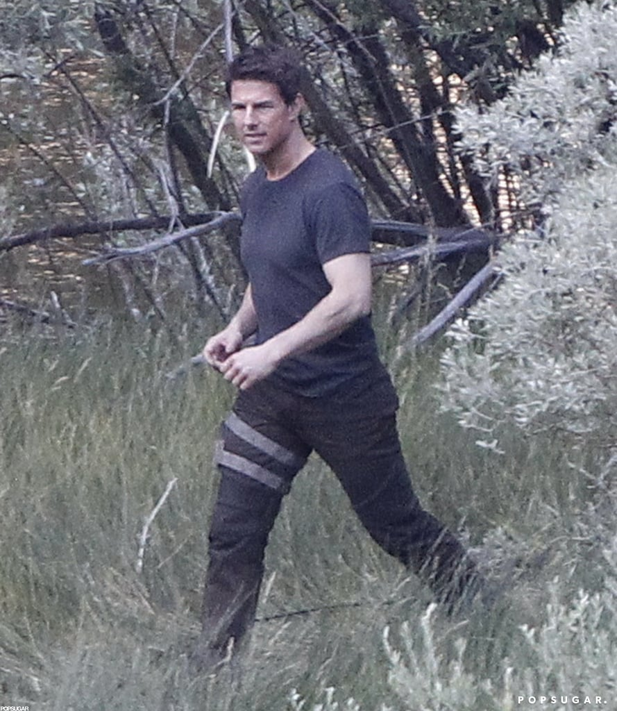 Tom Cruise made his way through some trees on the Oblivion set in CA.