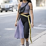 With a Pleated Statement Skirt