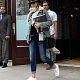 Jen Used Her Jeans to Play Up a Military Green Anorak and Wide-Brim Hat