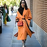 This street style star got a head start on the trend with an orange coat and matching Bulgari bag. The two different shades complemented each other and proved orange has staying power beyond Halloween.