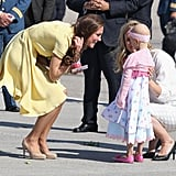 A young girl greeted the Duchess with flowers and a hug.
